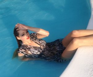 model looking beautiful in swimming pool with red lipstick